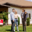Young couple speaks with real estate agent about septic system of new home